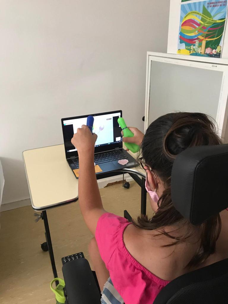 Person with Cerebral Palsy using the computer